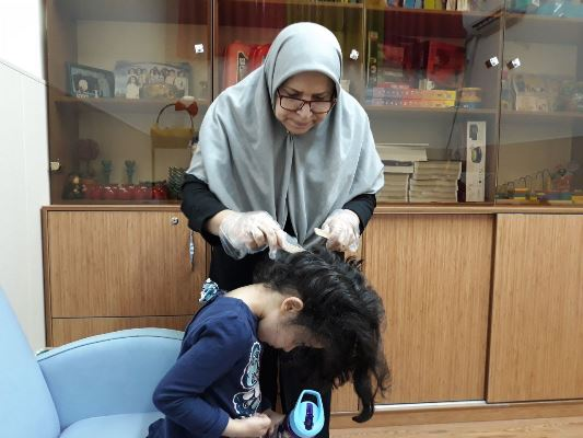 TIS Kindergarten 1st hair checkups by the school nurse